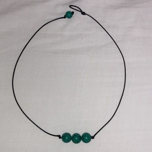 Jade pearls on black cord